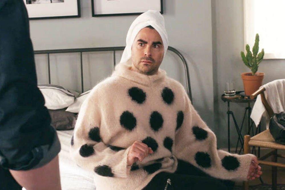 Dan Levy as David Rose wearing a beige mohair polka-dotted sweater in Schitt's Creek